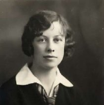 """Image of 1930 Alumni, Margaret McKee - """"1930 - Margaret McKee, Charter Years, c. 1929-1939""""  This is a portrait of  Margaret McKee wearing a dark colored suit jacket over a white, collared shirt and a striped necktie that is loosely tied."""
