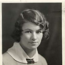 """Image of 1931 Alumni, Margaret Milne - """"1931 - Margaret Milne, Charter Years, c. 1929-1939""""  This is a portrait of Margaret Milne wearing a light colored, sweater with a white collar and a dark brooch at the neck."""