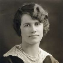 """Image of 1930 Alumni, Frances Murphy - """"Class of 1930 - Frances Murphy, Charter Years, c. 1929-1939""""  This is a portrait of Frances Murphy wearing a dark colored, velveteen shirt with a lace collar and a double strand of pearls."""