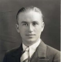"""Image of 1931 Alumni, Edwin Rodgers - """"1931 - Edwin G. Rodgers, Charter Years, c. 1929-1939""""  This is a portrait of Edwin G. Rodgers wearing a dark colored, pin-striped suit with a white dress shirt and a patterned necktie."""