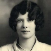 """Image of 1930 Alumni, Jean McShain - """"Class of 1930 - Jean McShain, Charter Years, c. 1929-1939""""  This is a portrait of Jean McShain wearing a light colored, blouse with a gathered collar and a string necklace tied in a tiny bow."""