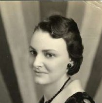 """Image of 1932 Alumni, Verna Smuckel Merrifield - """"1932 - Verna Smuckel Merrifield, Charter Years, c. 1929-1939""""  This is a portrait of Verna Smuckel Merrifield wearing a dark colored dress with a light colored v-neckline and large polka-dots.  Also, she is wearing a black beaded necklace and matching earrings."""