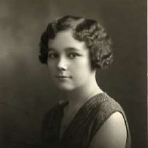 """Image of 1931 Alumni, Elizabeth Hess - """"Class of 1931 - Elizabeth Hess, Charter Years, c. 1929-1939""""  This is a portrait of Elizabeth Hess wearing a dark colored, v-neck sleeveless sweater and a delicate chain necklace."""