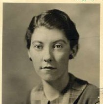 """Image of 1934 Alumni, Eileen Cochrane Lee - """"Class of 1934 - Eileen Cochrane Lee, Charter Years, c. 1929-1939""""  This is a portrait of Eileen Cochrane Lee wearing a medium colored jumper with a plaid shirt underneath."""