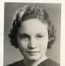 """Image of 1933 Alumni, Norma Gibbons - """"Class of 1933 - Norma Gibbons, Charter Years, c. 1929-1939""""  This is a portrait of Norma Gibbons wearing a dark colored shirt with a brooch at the neckline."""