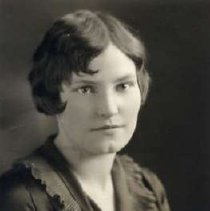 """Image of 1930 Alumni, Helen Colton - """"1930 - Helen C. Colton, Charter Years, c. 1929-1939""""  This is a portrait of Helen C. Colton wearing a dark colored blouse with a ruffley collar and a tie with a brooch on it."""