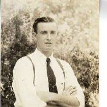 "Image of 1935 Alumni, Cecil Richards - ""1935 - Cecil Richards, Charter Years, c. 1929-1939""  This is a portrait of Cecil Richards wearing a white dress shirt, a dark colored tie and suspenders."