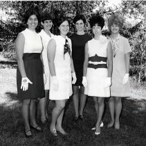 """Image of 1970 Evensong Royalty 1-1 - """"1970 - Evensong Court, left to right:  Sue Bonn, Barb Zickler, Linda Zornes, Sarah Tomeraasen, Queen Karen Ceniga (with orchid), Katherine Kovach.""""  [This photo appears in the 1970 Mountaineer yearbook, pg. 119.]"""