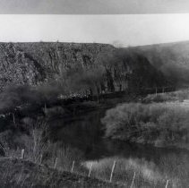 "Image of 1905 Oregon, Train - ""Railroad""  This is a photo of a train travelling along a river.  It appears to be a coal burning engine as there are billows of dark smoke flowing from the smokestack."