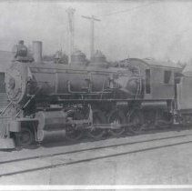 "Image of 1910+/- Oregon, Locomotive 1 - ""Railroad""  This is a photo of a locomotive and the fuel car that is attached directly behind it."