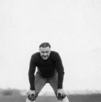Image of 1932 Football Player 2 - This is an informal, action shot portrait of an unidentified Eastern football player.  He is wearing uniform pants, and a dark colored, long sleeved, padded, shirt.