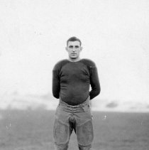 Image of 1932 Football Player 3 - This is an informal, action shot portrait of an unidentified Eastern football player.  He is wearing uniform pants, and a dark colored, long sleeved, padded, shirt.