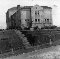 """Image of 1930-32 Inlow Hall - """"1930-32""""  This is a picture of Inlow Hall from a side of the building not covered often.  In the early days, people used the open area next to the building to park their cars.  A long staircase runs down the hill where saplings have been planted.  On the front of the building there are discolorations near the windows."""