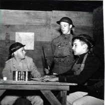 "Image of 1962 ""Journey's End"" - ""Spring 1962 - 'Journey's End' - Theatre, Sock & Buskin""  A WWI bunker scene from ""Journey's End.""