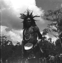 "Image of Dobodura Natives Celebration 2 - ""A native participant, wearing bird beak head dress, in a big celebration near Dobodura, Papua New Guinea"" 17th Recon"""