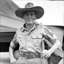 "Image of Walt Peters, Medic Section - ""Medic Section's Walt Peters with locally acquired straw hat - Walt was a member of the six tentmates who lived together through many moves"""