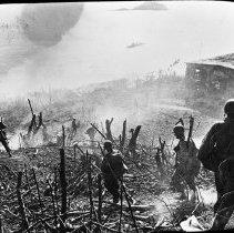"Image of 503rd Parachute Infantry 3 - ""503rd Combat Parachute Infantry striding across botanical debris on Corregidor - perhaps Feb 17 - Signal Corps Photo from Lantern slide - Bob Flynn, 503 historian"""