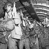 """Image of 503rd Parachute Infantry 4 - """"Signal Corps Photo.  503rd RCT members in C-47 hooked to static line ready to jump - Sgt Albert Baldwin of Steubenville, Ohio leads the jump in first positition - Signal Corps original, from Lantern Slide from Bob Flynn - fairly sharp"""""""
