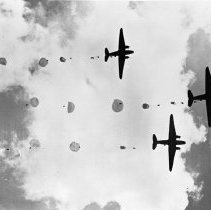 """Image of 503rd Parachute Infantry 5 - """"Signal Corps Photo - from ground looking up at 503rd Parachute Infantry being delivered by Troop Carrier C-47's, Feb 16 1945"""""""