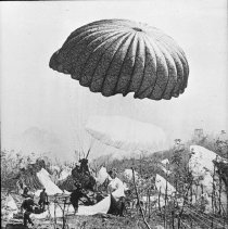"""Image of 503rd Parachute Infantry 7 - """"503rd Paratrooper landing - 'Chute still inflated - Signal Corps Photo - from Lantern slide from Bob Flynn - 503rd historian"""""""