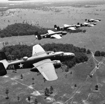 "Image of Aerial, B-25's Formation 1 - ""5 B-25's in flight - perhaps over Louisiana.  Serial numbers:  130420, 130443, 232237, 230477, unknown""