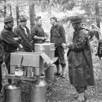 """Image of 186th Infantry, Field Kitchen 1 - """"E Co. 186th Infantry - Field exercises - Fort Lewis 1941 - field Kitchen - WW1 helmets"""""""