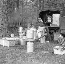 """Image of 186th Infantry, Field Kitchen 3 - """"E Co. 186th Infantry - Field exercises - Fort Lewis 1941 - field Kitchen - WW1 helmets"""""""
