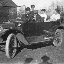 Image of Automobile, Day Ride 1 - Three women and two men ride in an automobile.