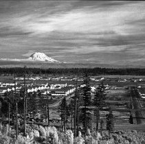 "Image of 41st Cantonment Area - ""41st Div. Cantonment Area Barracks - theatre building - Mt. Rainier in distance - Taken by Fred Hill from water tank atop a ridge 1941 - Infra Red negative"""