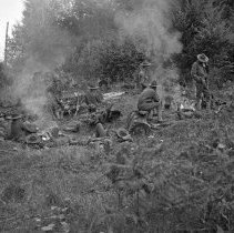 """Image of 186th Infantry, Field Camp - """"186th Infantry - 41st Division - Overnight hike - Fort Lewis - 8/40 - National Guard annual encampment before we were mobilized Sept. 16, 1940 - getting up in morning - fires to get warm"""""""