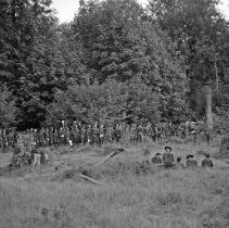 """Image of 186th Infantry, Chow Line - """"186th Infantry - 41st Division - Overnight hike field training - Fort Lewis - 8/40 - National Guard annual encampment before we were mobilized Sept. 16, 1940 - line up for chow in the field - all with mess kits"""""""