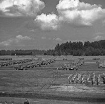 "Image of 41st Division, Corps Review 3 - ""41st Division 1941 - There was a huge Corps Area review staged on Ft. Lewis proper - negatives by Bob Spencer with Fred Hill's speed graphic camera from top of water tower"""