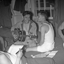 """Image of 41st Division, Recreation 4 - """"41st Division 1941 - Recreation:  Guitar music / singing  41st Cantonment - The first group of draftees that came to the 186th Infantry for training had many Hispanic men - Here they are singing to guitar accompaniment"""""""