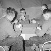 """Image of 41st Division, Recreation 5 - """"41st Division 1941 - Recreation:  card game  Cpl Bill Hawes - 4th Squad (Mortar) leader - Gail Mills on right - in barracks at 41st Cantonment area"""""""