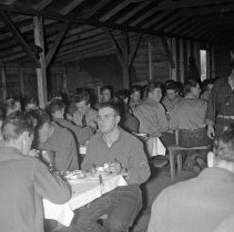 "Image of 41st Cantonment, Mess Hall 2 - ""41st Division 1941 - Pertaining to the new 41st Cantonment area - N. Ft. Lewis - E.M. Mess hall at meal time"""