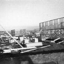 "Image of 41st Cantonment, Construction 2 - ""Construction of theatre & PX buildings - 41st Cantonment - North Fort Lewis - 1941"""