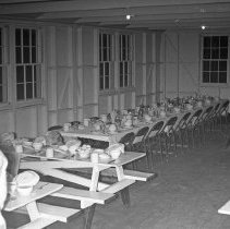Image of 41st Cantonment, Mess Hall 3 - 41st Cantonment Mess Hall.  Seating is arranged in preparation for a hosted dinner of Battalion officers.