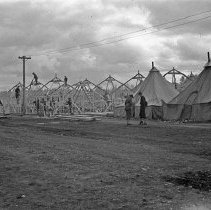 "Image of 41st Division, Camp Murray 4 - ""41st Division - Oct. 1940""  Construction of 1st Squad tents - no floors"