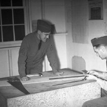 "Image of 41st Cantonment, Carpentry - ""41st Division E Company 186 Infantry Fort Lewis 41st Cantonment Area - Sgt Robert Spencer advises 1st Sgt Howard Petersen in some cabinet carpentry"""