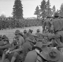 """Image of 186th Infantry, Assembled Companies 1 - """"41st Div. - August 1940 - Fort Lewis back country - A great gathering of the 186th Infantry Companies - Camp Murray pyramidal tents in distance"""""""
