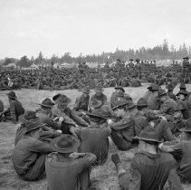 """Image of 186th Infantry, Assembled Companies 2 - """"41st Div. - August 1940 - Fort Lewis back country - A great gathering of the 186th Infantry Companies - Camp Murray pyramidal tents in distance"""""""