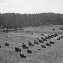 "Image of 41st Division, Camp Murray 6 - ""41st Division - Jan. 1941 - Views over Camp Murray from the top of the water tower - motor pool - tent areas - taken by Sgt. Bob Spencer using Fred Hill's speed graphic camera"""