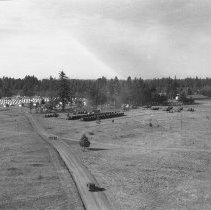 "Image of 41st Division, Camp Murray 9 - ""41st Division - Jan. 1941 - Views over Camp Murray from the top of the water tower - motor pool - tent areas - taken by Sgt. Bob Spencer using Fred Hill's speed graphic camera"""