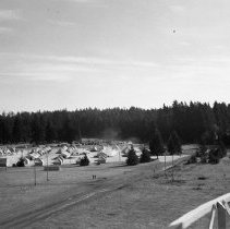 "Image of 41st Division, Camp Murray 12 - ""41st Division - Jan. 1941 - Views over Camp Murray from the top of the water tower - tent areas - taken by Sgt. Bob Spencer using Fred Hill's speed graphic camera"""