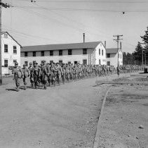 "Image of 41st Cantonment, Hike - ""The start of a 10 mile hike from 41st Division Cantonment Area - steel helmets (WW1 variety) and battle packs - 1940/41"""