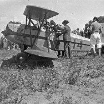 """Image of La Grande, Air Show 15 - """"Barnstorming bi-plane - 193? - Tex Rankin - in a hay field at Hot Lake"""""""