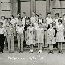 """Image of 1934-35 Ackerman Elementary 1 - """"1934-35 Ackerman, A.19.""""  This is the class of 1934-35 at Ackerman Elementary School.  The picture was taken outside of the building."""