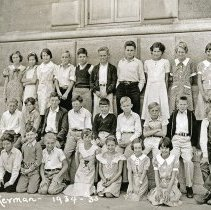 """Image of 1934-35 Ackerman Elementary 3 - """"1934-35 Ackerman, A15.""""  This is the class of 1934-35 at Ackerman Elementary School.  The picture was taken outside of the building."""