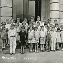 "Image of 1934-35 Ackerman Elementary 4 - ""1934-35 Ackerman, A.8""  This is the class of 1934-35 at Ackerman Elementary School.  The picture was taken outside of the building."