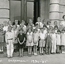 "Image of 1934-35 Ackerman Elementary 5 - ""1934-35 Ackerman, A.14""  This is the class of 1934-35 at Ackerman Elementary School.  The picture was taken outside of the building."